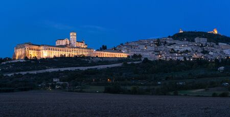 Panoramic landscape. Assisi Basilica of St. Francis at sunset. Night amazing view