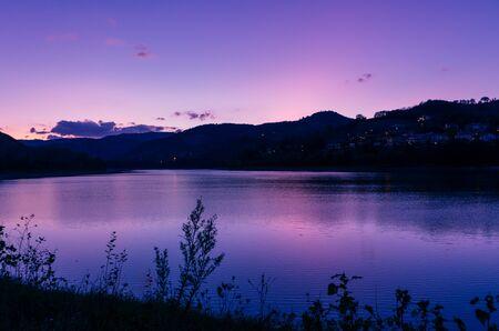 purple sky at sunset over mountain lake. panoramic landscape, twilight sky Zdjęcie Seryjne