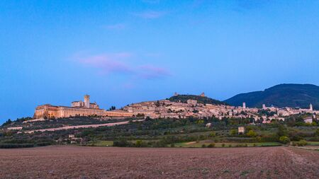 Panoramic landscape. Assisi Italy Basilica of St. Francis at sunset. Sunset amazing view