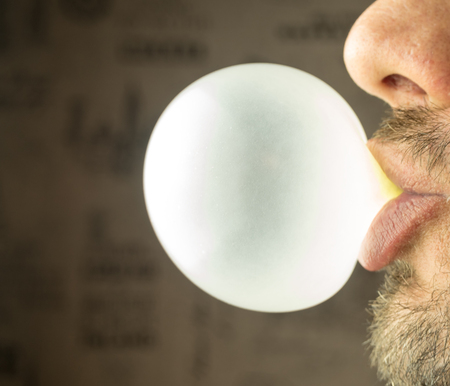 Bearded guy inflates a bubble of gum
