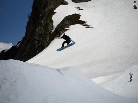 Guy snowboarder jumps on a springboard ski resort Gorky-gorod. Russia Sochi 05.11.2019 Éditoriale