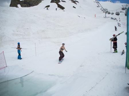 Snowboard water competition girl in swimsuit ski resort Gorky-Gorod. Russia Sochi 05.11.2019