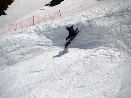 The guy skier jumps on the springboard the ski resort Gorki-town. Russia Sochi 05.11.2019 Éditoriale
