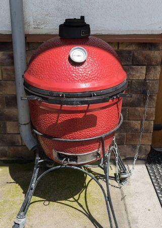 Ceramic grill - kamado barbecue stands on street. Rosa Khutor 免版税图像