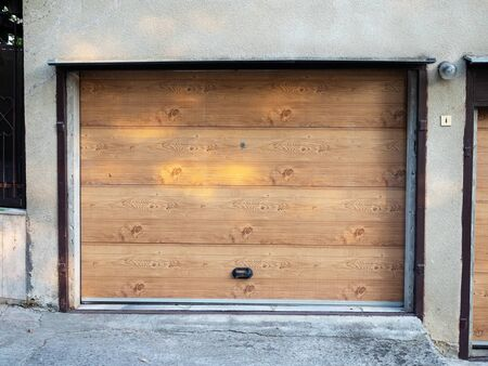 Facade of garage with wooden gates during the day Foto de archivo