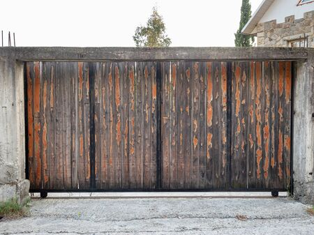 Temporary sliding gate made old painted wood