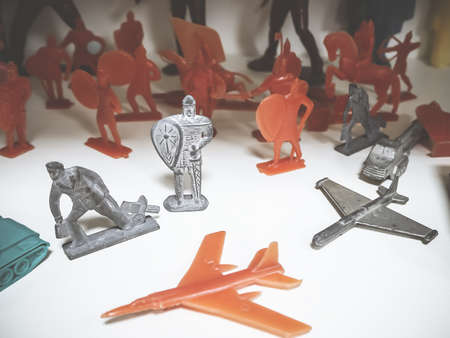 Soviet toy plastic red and gray tin soldiers and airplanes. Childrens toys of the USSR