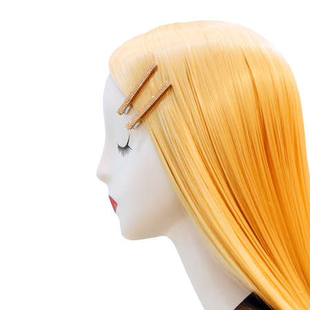 Profile of female mannequin with blond hair on isolated background