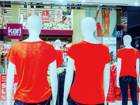 Sochi, Russia - 14 December 2019. Mannequins in red T-shirts, view from the back in a mall store