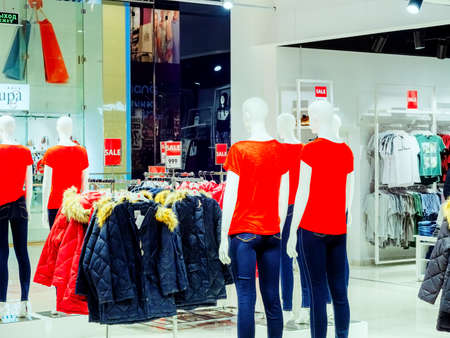 Sochi, Russia - 14 December 2019. Mannequins in jeans and red T-shirts in the store against the background of winter jackets and other mannequins
