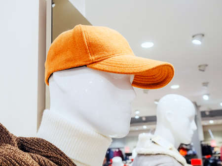 Head of a white male mannequin wearing a red cap