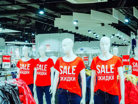 Sochi, Russia - 14 December 2019. White mannequins in red t-shirts with the inscription SALE stand in a row in the store
