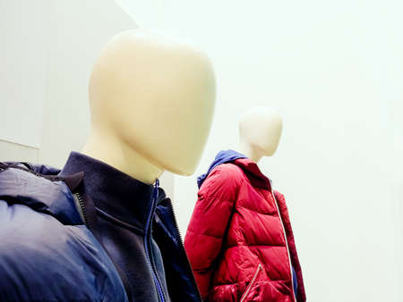 White male abstract mannequins in padded quilted winter jackets