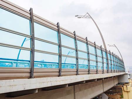 Modern transport overhead bridge with a blue transparent fence