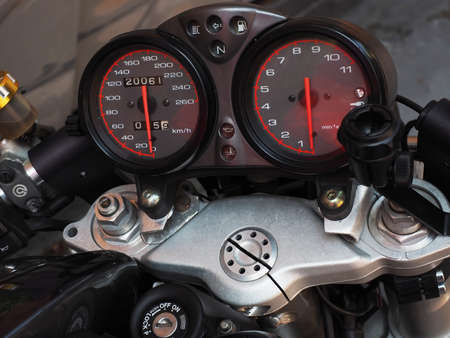 The instrument panel with two circular speedometers is located on the handlebars of the motorcycle. Closeup photo 版權商用圖片