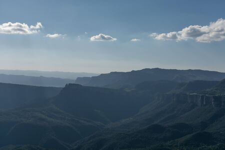 Mountain scape with some clouds at Catalonia, Spain. Sun bathing with its rays the mountains in a charming scenario