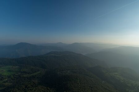 Sunbath of mountains with forests under a blue sky panorama at Catalonia, Spain
