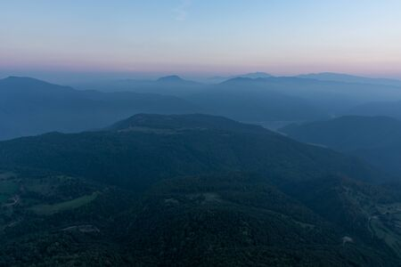 Mountain range panorama, scene tinted in blue due to evening time at Catalonia, Spain
