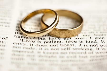 Love is patient with wedding rings Stock fotó