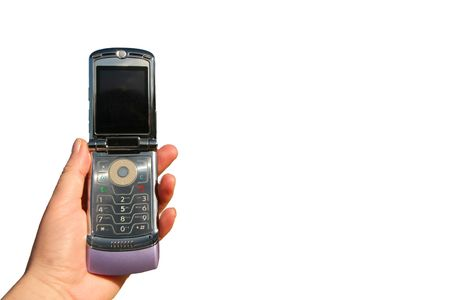 flip phone: hand holding cell phone