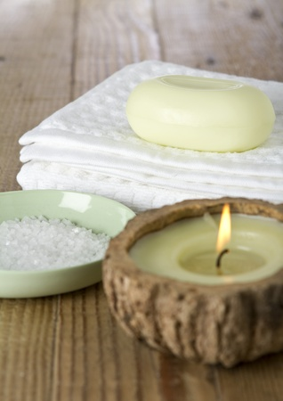Close up of day spa items including soap, towel, candle and bath salts Stock Photo