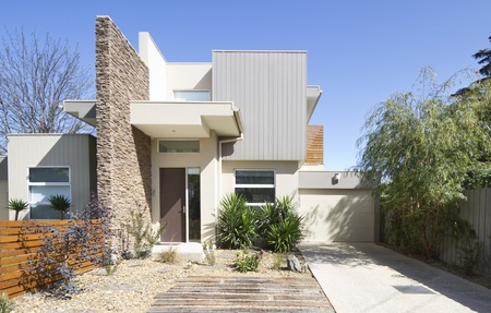 blue facades sky: Front of a two storey contemporary architect designed townhouse home Stock Photo