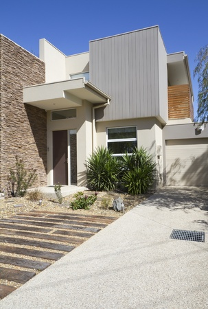 carpark: Side angle of a double storey architec designed townhouse home