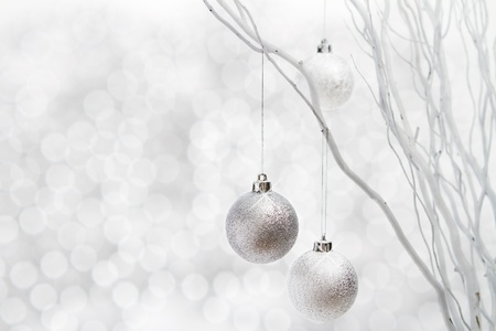 Christmas background of silver ball decorations on white sparkle background Stock Photo