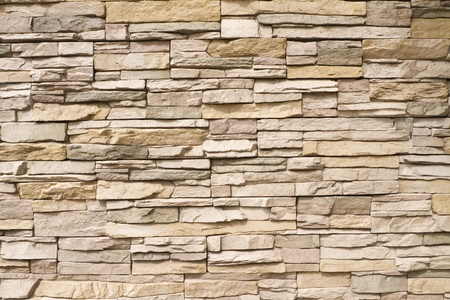 Background of a contemporary stacked stone wall in warm brown tones photo