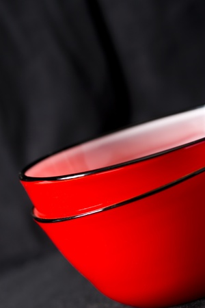 Contemporary design red bowls on a black background