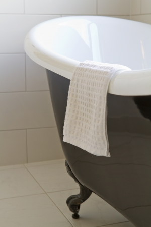 Close up of a black claw foot bath in a contemporary bathroom