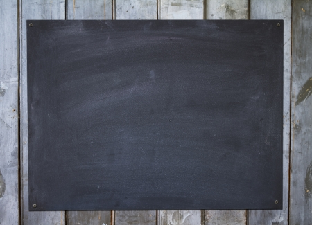Horizontal blackboard on a rustic old fence background