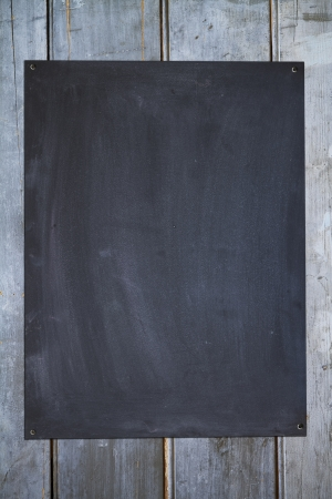 vertical blackboard on a rustic old fence background Stock Photo