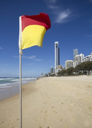 no swimming: Close up of a safe swimming area flag at surfers paradise queensland Stock Photo