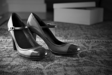 Pair of vintage style shoes on a stylish rug in black and white
