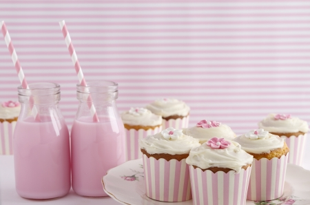 flavoured: Pink retro striped theme dessert table at a girls birthday party horizontal