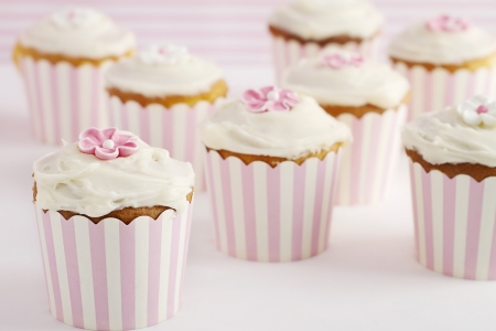Dessert table of pink and white retro style cupcakes horizontal Stock Photo