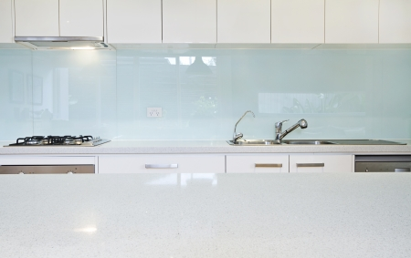 stone worktop: Close up of a kitchen splashback and bench Stock Photo