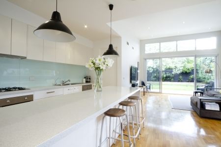 oven and range: Contemporary kitchen and open plan living room with garden aspect