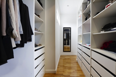 Contemporary spacious walk in wardrobe in a modern home photo