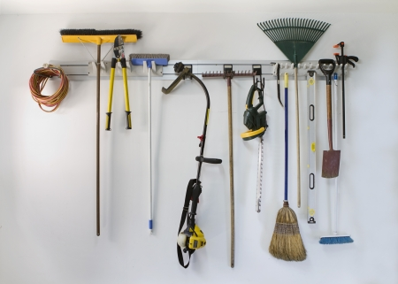 neat: Neat garage tools hanging on a storage rack Stock Photo