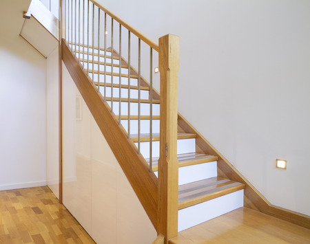 European Oak starcase with white risers in a contemporary architect designed home Stock Photo