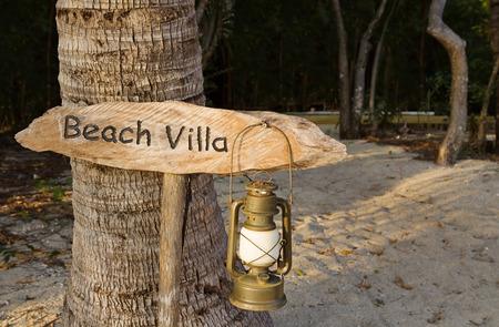 Holiday home beach villa sign made of wood photo