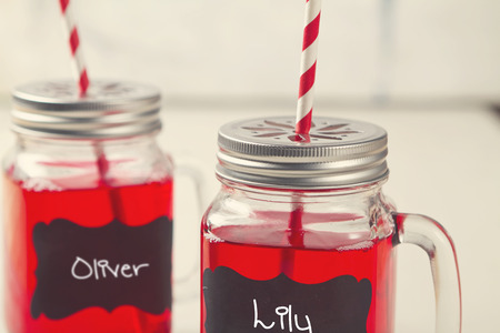 Kids party lemonade drinks in mason jars with Oliver and Lily names Stock Photo