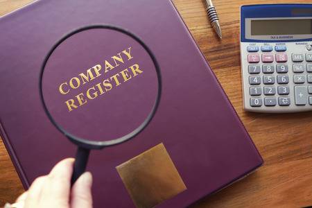 Purple Company Register under magnifying glass