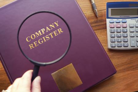 secretarial: Purple Company Register under magnifying glass