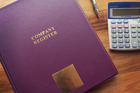 register: Purple Company Register binder with pen and calculator