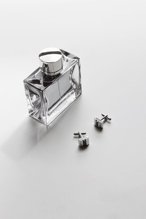 aftershave: Vertical mens cologne and cufflinks monochrome