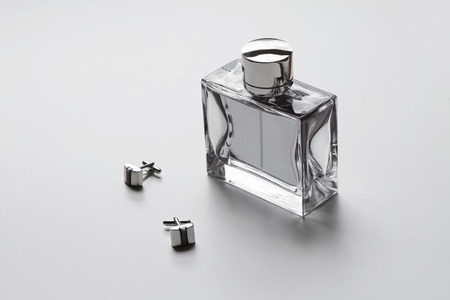 men's: Horizontal mens cologne and cufflinks monochrome Stock Photo