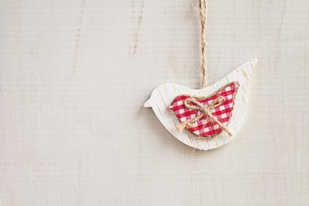White dove Christmas decoration hanging on white wooden background horizontal Stock Photo